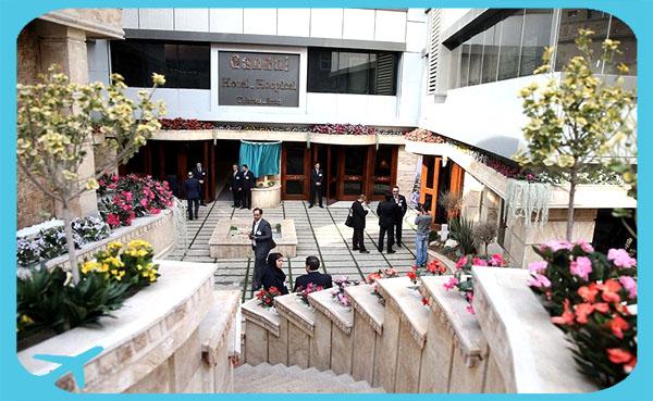 Gandhi hotel hospital entrance with people