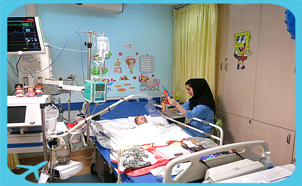 nurse playing with child patient representing quality of medical care in Iran