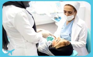 female dentist and assistant in clinic of iran