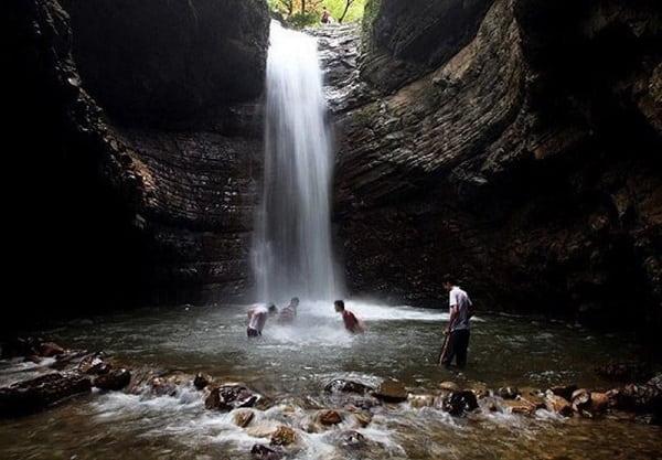 iranian boys swimming in Visadar waterfall in gilan province