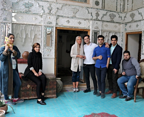 woman traveler visiting Golestan palace with AriaMedTour staff