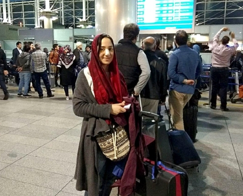 female traveler in tehran airport