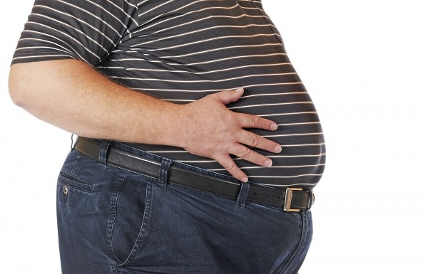 obese man touching his stomach
