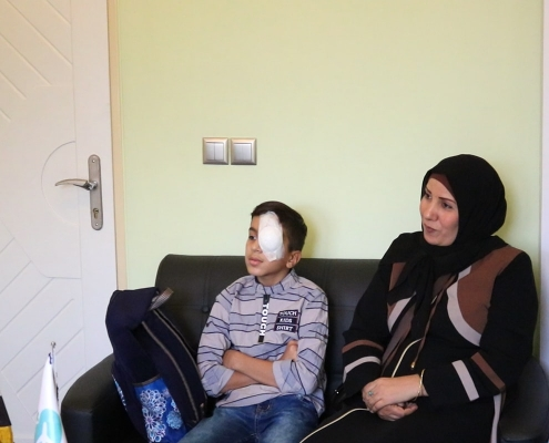 patient getting pediatric eye surgery in Iran