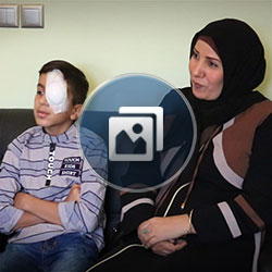Iraqi boy patient with mom having eye surgery in Iran