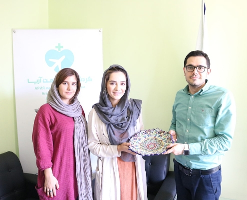 Woman from Holland receiving gift from AriaMedTour medical tourism agency in Iran