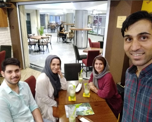 Afghan-Dutch girl and AriaMedTour's coordinators in a coffee shop in Tehran
