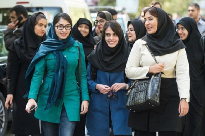 a group of iranian women with different clothing and hijab