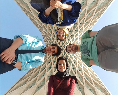 people taking photo with azadi tower
