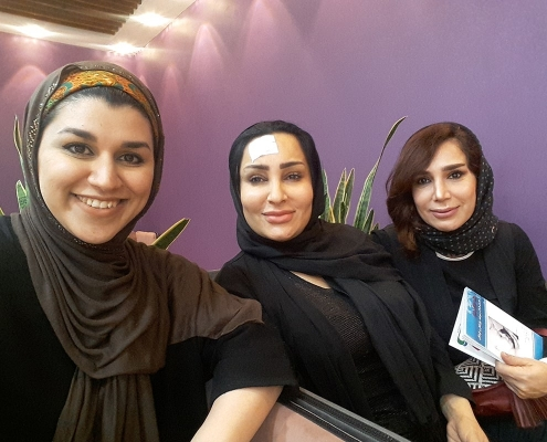 medical tourists and interpreter take selfie in Iran