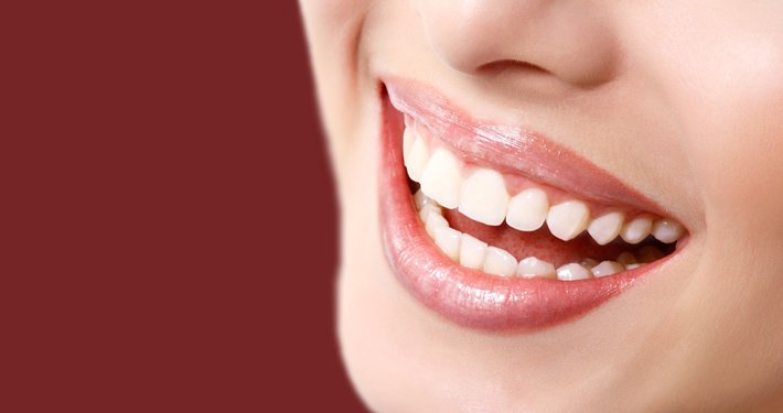 woman's mouth with white teeth
