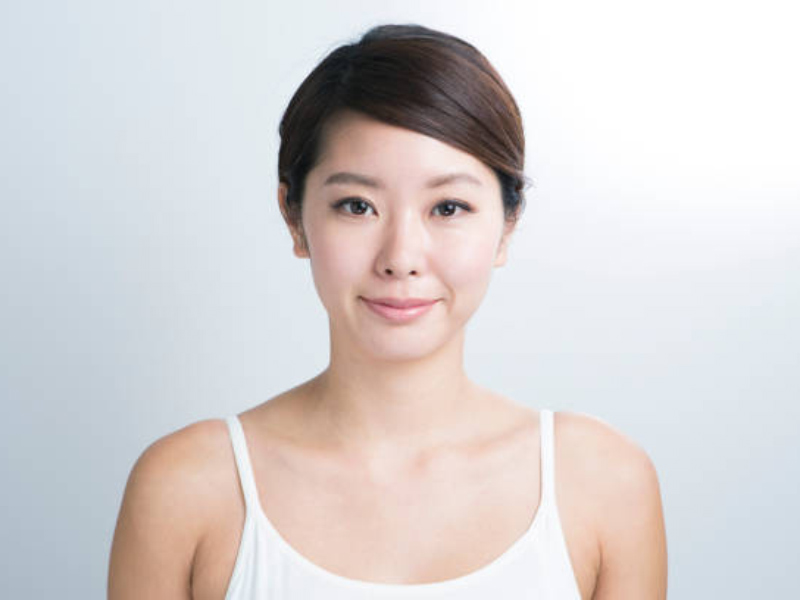 Asian girl from Korea with short hair and small nose standing in front of the camera