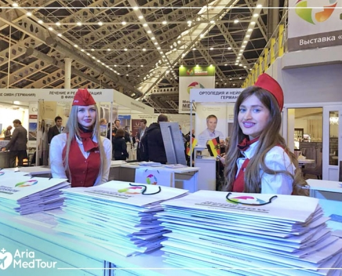 Two Russian girls in Medshow exhibition in Russia Moscow