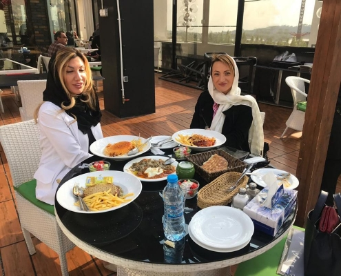 rhinoplasty medical tourists having launch in a luxury restaurant in tehran