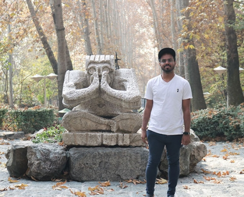 Saeed poses for a photo at a tourist attraction in Tehran