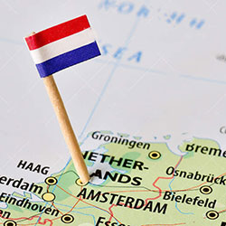 tiny Dutch flag stuck into the map of the Netherlands