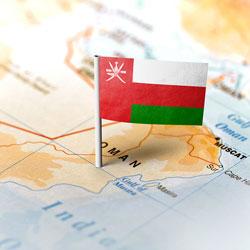 Omani flag stuck into Oman's map