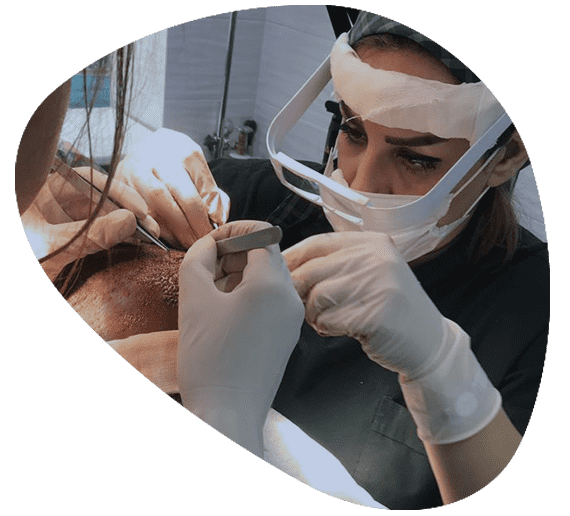 Iranian surgeon and assistant performing hair transplant in a modern clinic