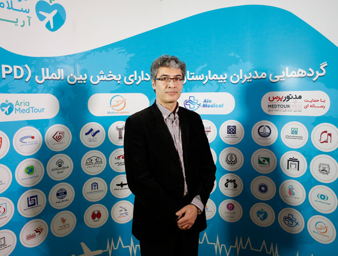Dr Saeed Hashemzadeh, head of the health tourism department of Iran's ministry of health posing for a photo
