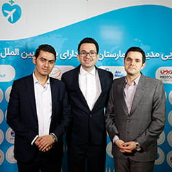 AriaMedTour's and AloMedical's officials posing for a photo at Tehran's health tourism conference
