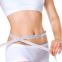 women with a measuring tape around her waist after liposuction