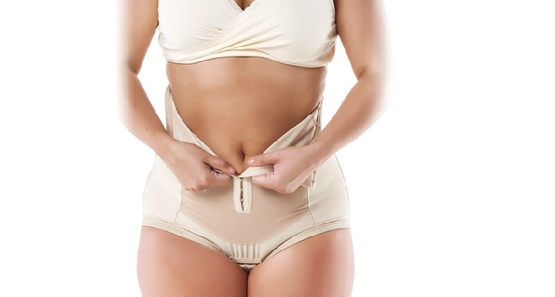 woman wearing compression garment after liposuction
