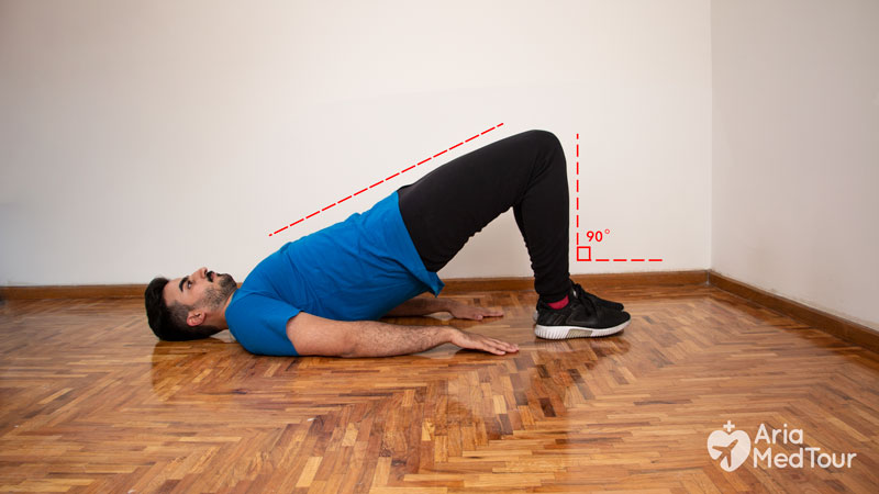 man doing bridging exercise at home to ease his knee pain