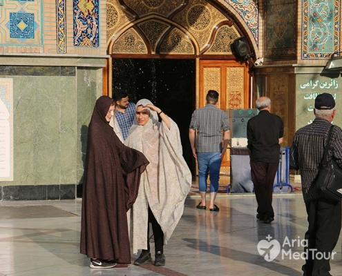 Female tourist and her interpreter with Hijab visit holy shrine in Tehran