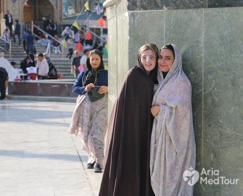 Female traveler and medical tourist wearing Chador in Imamzadeh Saleh holy shrine