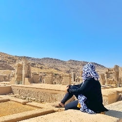 tourist observing the beauty of Persepolis
