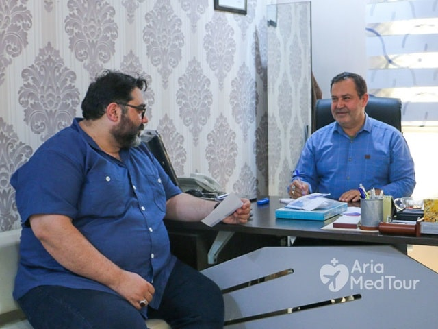 obese man in doctor's office receiving consultation before weight loss surgery