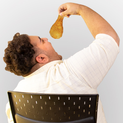 young fat man eating chicken with his mouth wide open