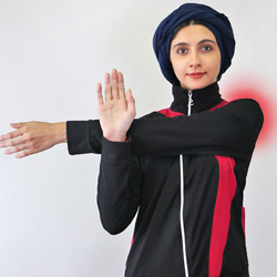 woman stretching her arms and doing exercise to help reduce shoulder pain