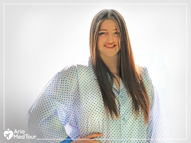 beautiful fat woman wearing hospital gown and smiling to the camera after weight-loss surgery