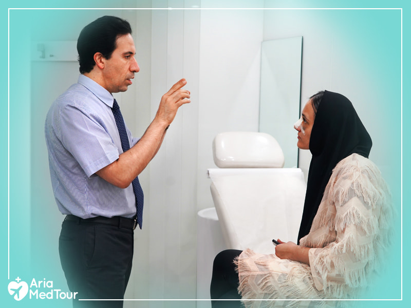 Iranian doctor giving advice to her rhinoplasty patient on post-op rhinoplasty aftercare in his office