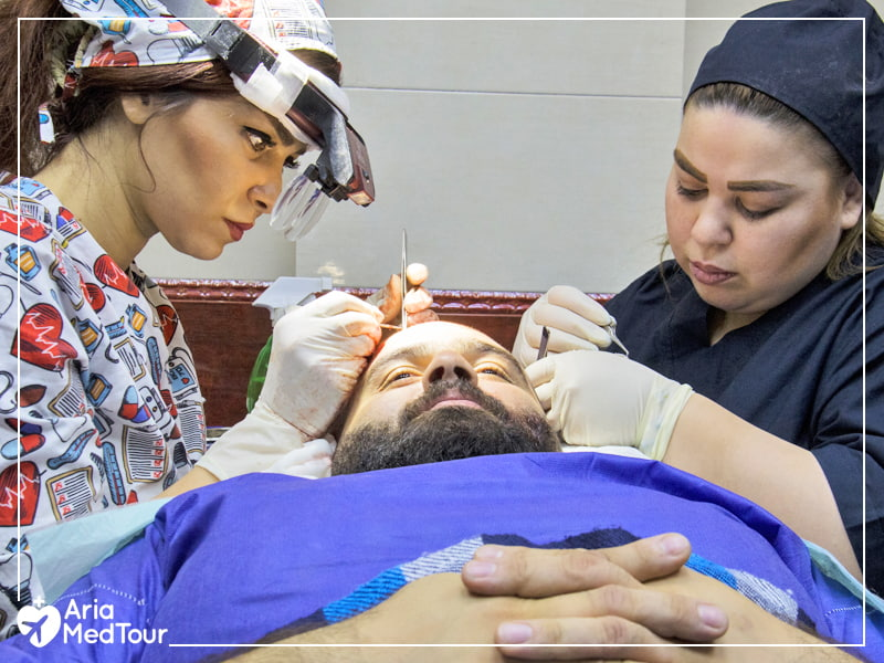 surgeons doing hair transplantation on a patient under local anesthesia