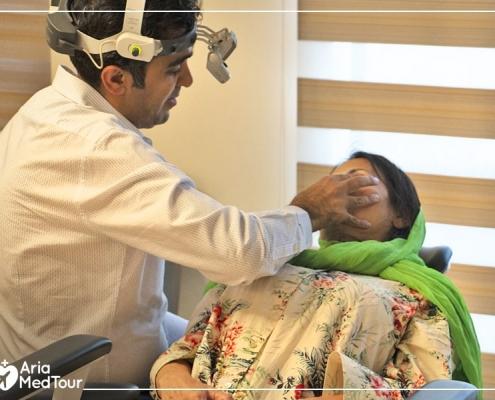 Docotr examining Melissa's nose