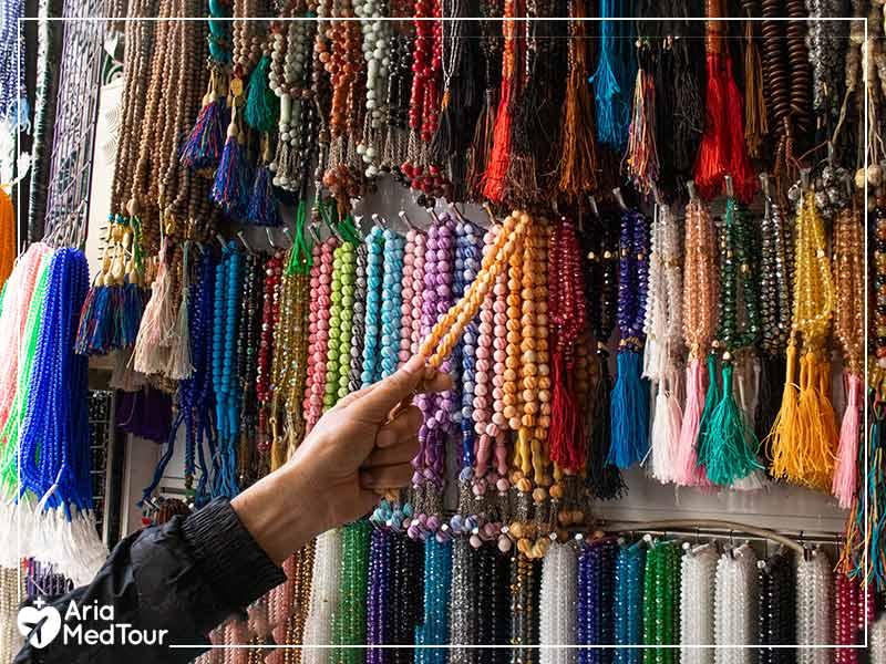 man checking various rosaries