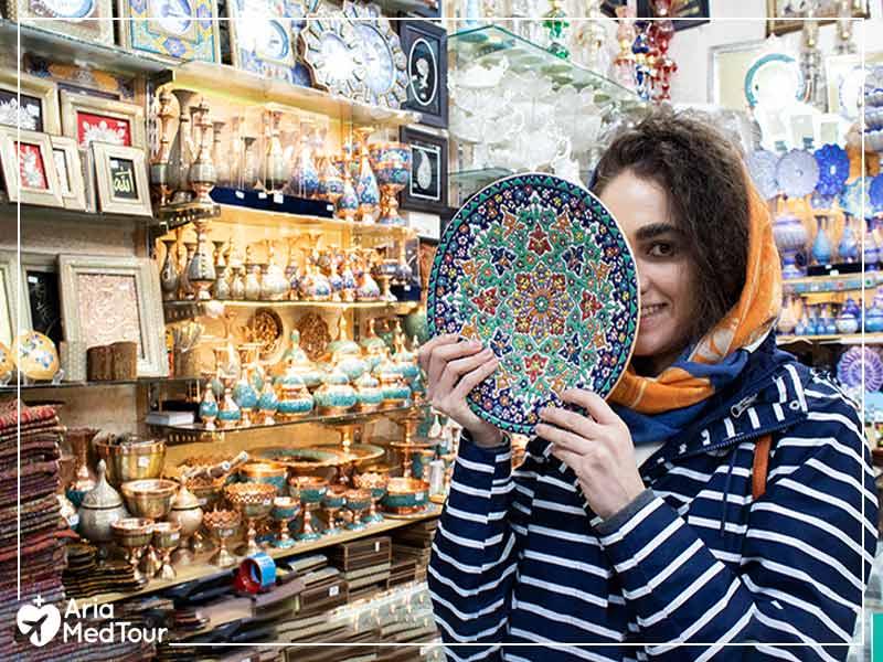 girl holding a minakari handicraft