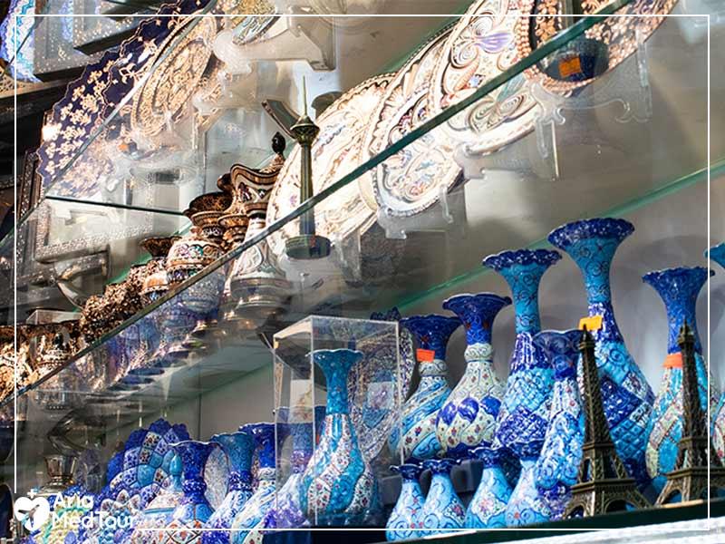 a shelf of Iranian handicrafts