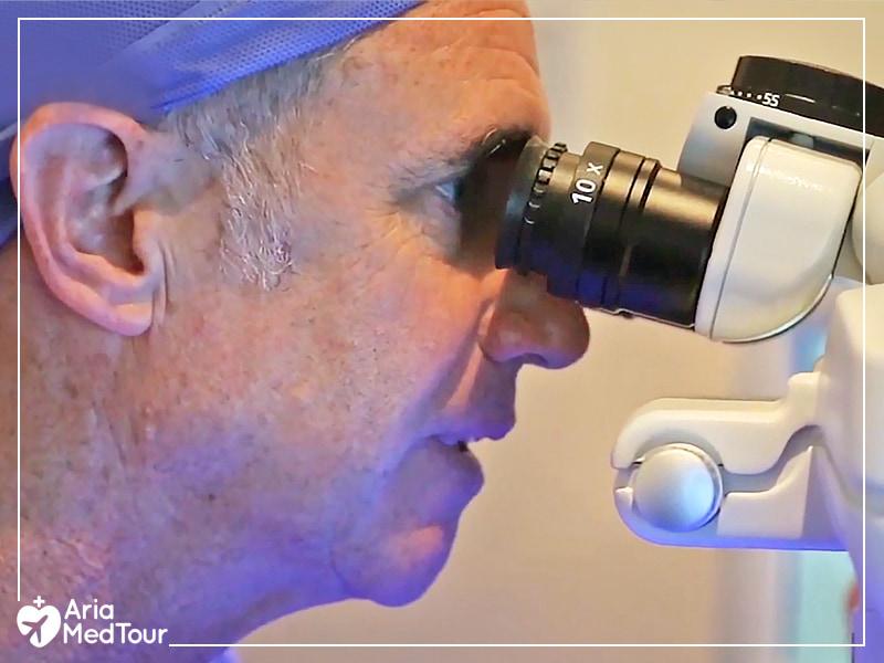 Iranian eye surgeon examining his patient