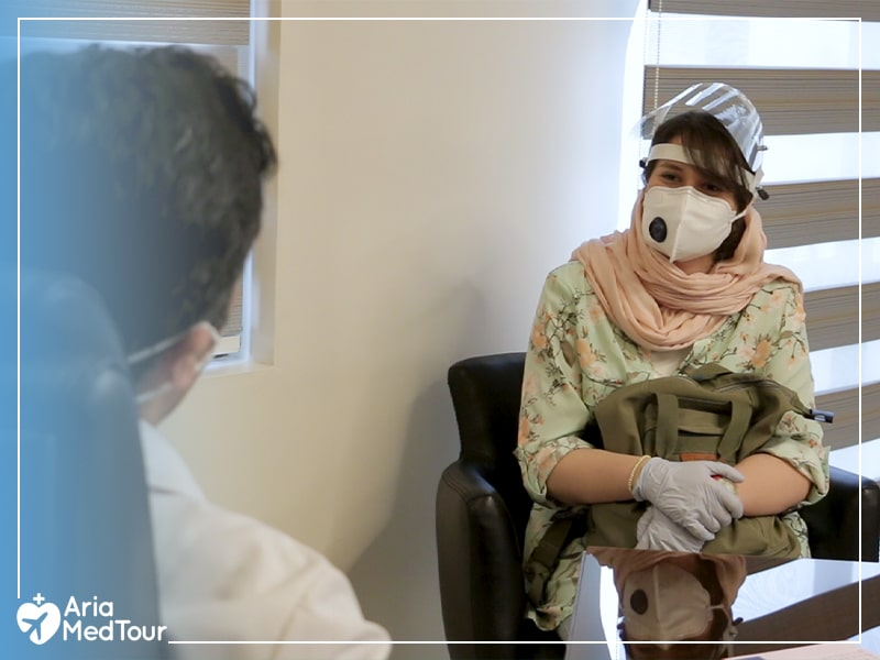 Patient and doctor in the clinic with hygiene protocols