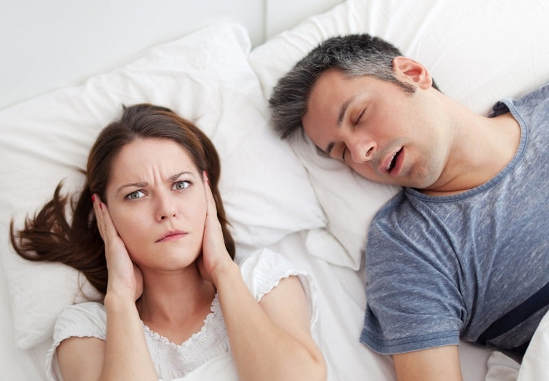 snoring being annoying and can bother the people who may sleep nearby