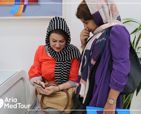 Iraqi patient with her interpreter in the Doctor clinic in Tehran