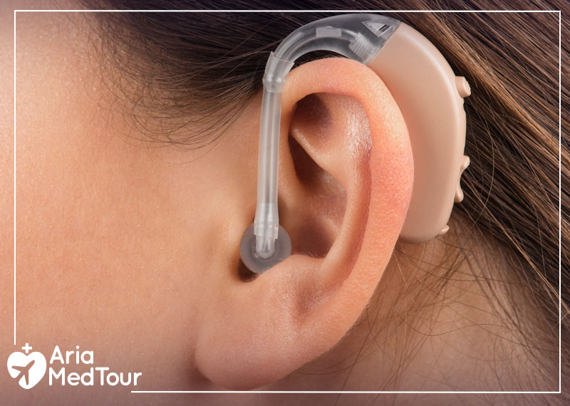 a girl using hearing aids to to improve her hearing