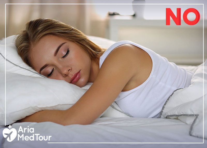 a woman sleeping on her stomach which is considered as a wrong sleeping position after rhinoplasty