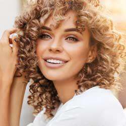 a girl after dental veneers laminates